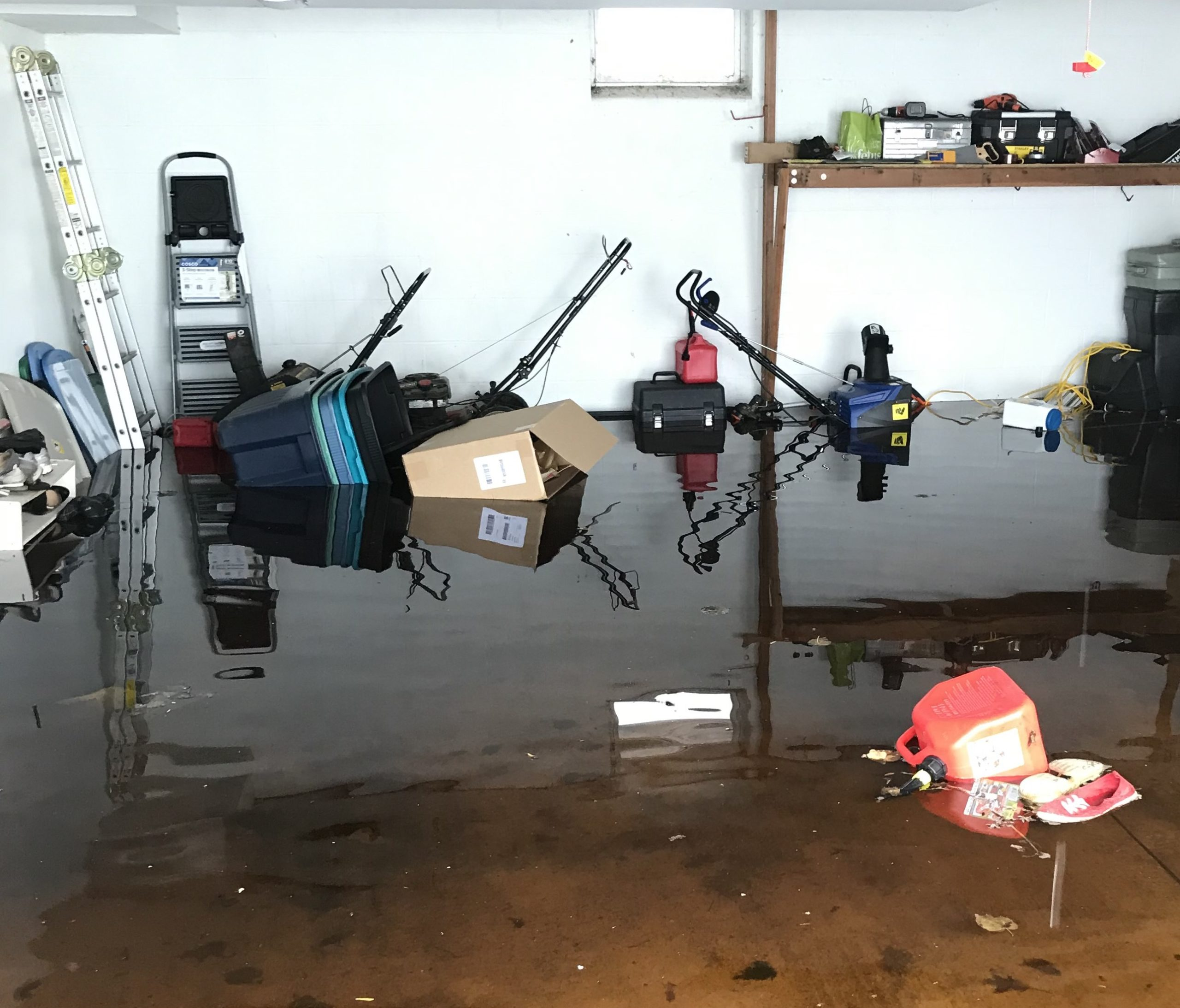 Picture of a flooded garage after snow melted in the spring.