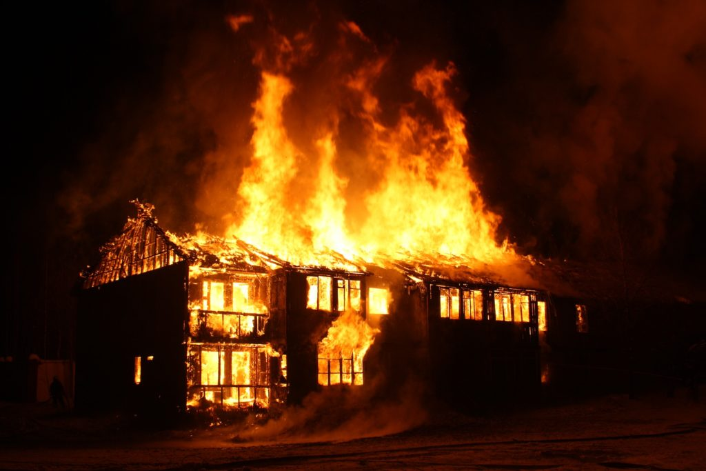 Picture of a residential house on fire.